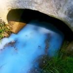 foamy-blue-water-flowing-from-culvert-1