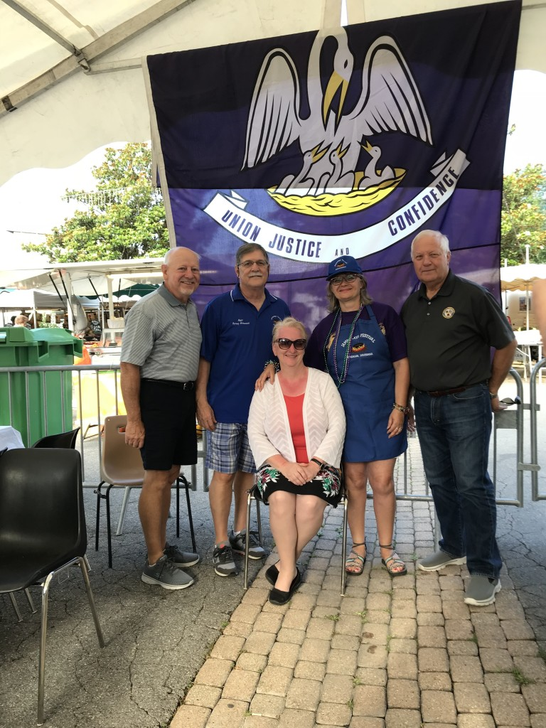 Kicking off the Jambalaya Festival 2018 in Meylan. L-R: Parish Councilman John Cagnolatti, Gonzales Mayor Barney Arceneaux, GCCA President Karen Hatcher (seated), recently retired Meylan Jumbelage President Mireille Adji Anastasiou, and Gonzales Councilman David Guitreau.